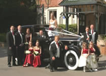 Wedding party with car